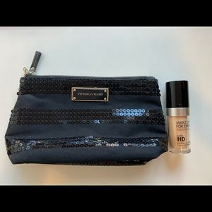 Make Up For Ever Foundation with a makeup bag